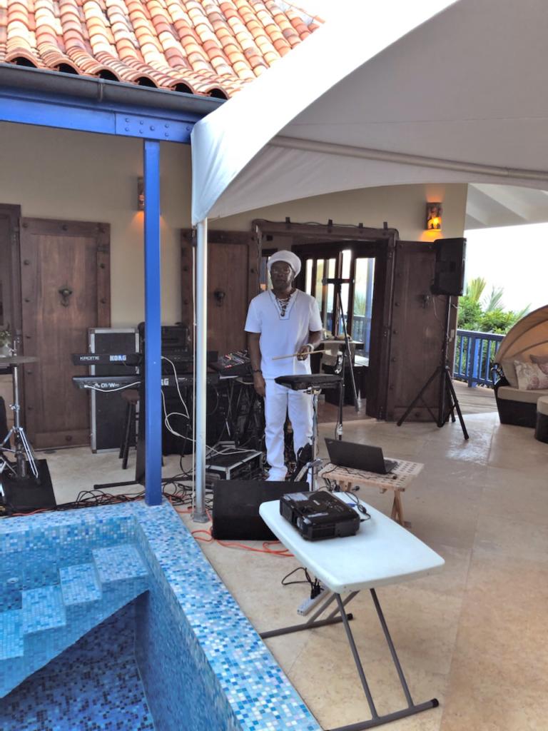 Jakhama, leader of Reggae Dynasty setting up to play at a St. Thomas villa